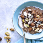 Chocolate oat porridge with nuts.Top view.
